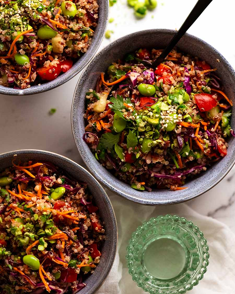 Overhead photo of 3 bowls filled with Quinoa Salad
