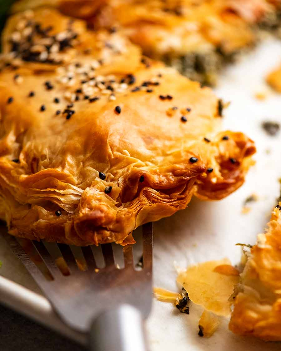 Close up showing crimped edge of flaky phyllo pastry edge of Spanakopita