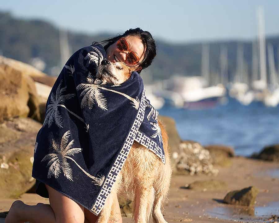 Nagi hugging Dozer with beach towel