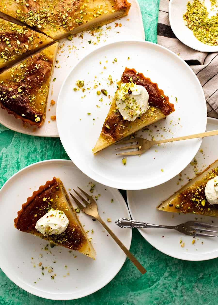 Overhead photo of Pistachio Pear Tart slices being served