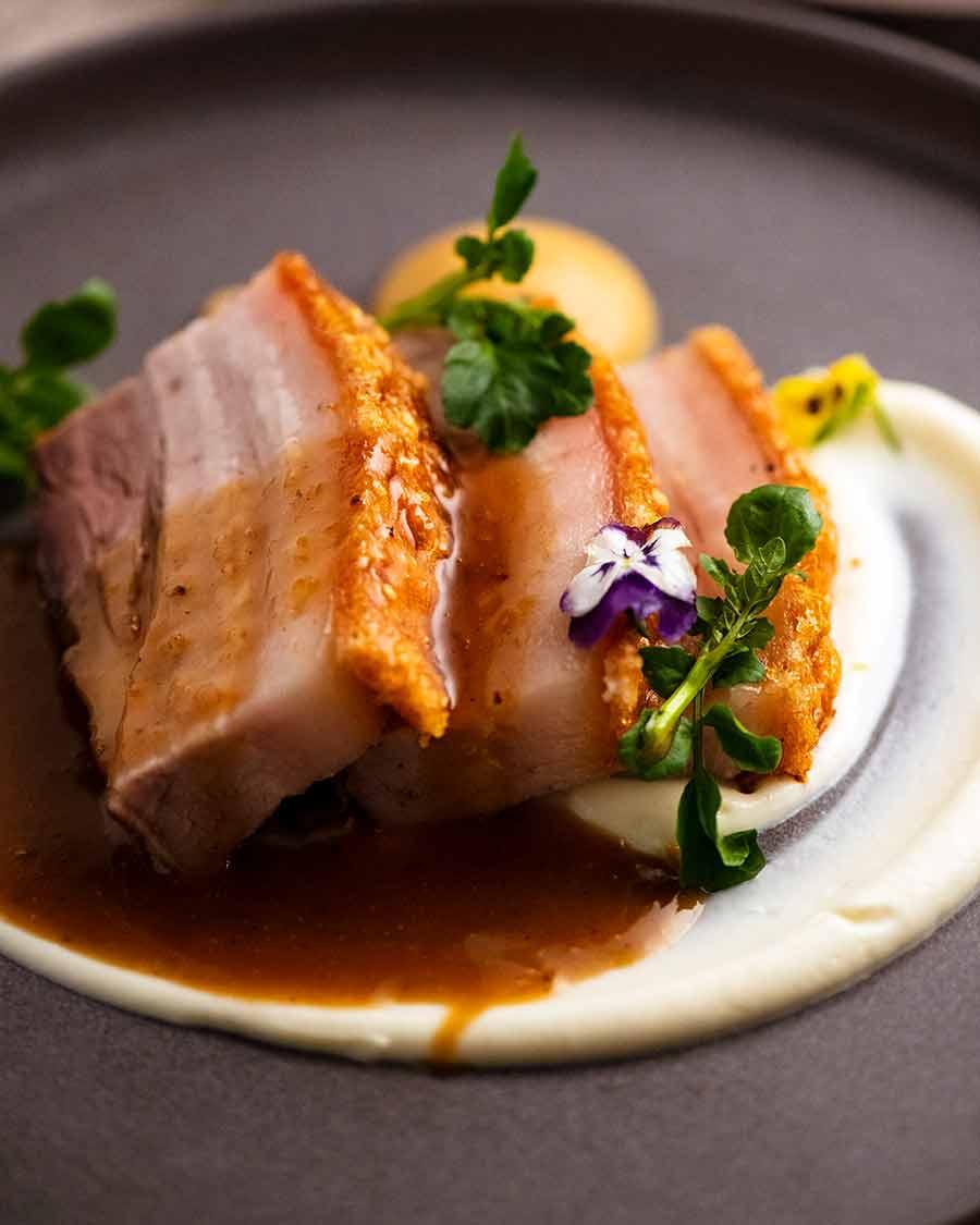 Fine dining restaurant plating of Slow Roasted Crispy Pork Belly