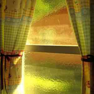 yellow glass windows with colorful curtains