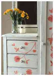 yellow flowers on a piece of painted furniture