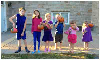 kids_showing_off_their_painted_pumpkins