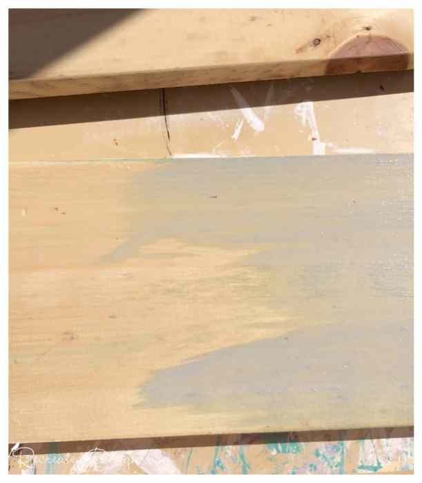 pine board being washed with Miss Mustard Seed Milk Paint in Shutter Grey