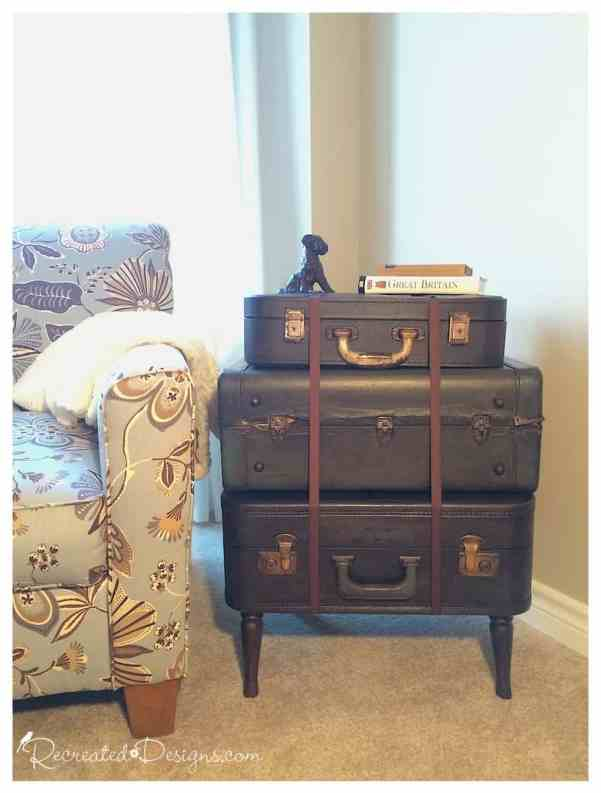 stack of vintage suitcases made into side table