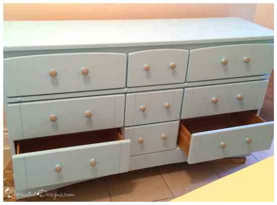 old dresser being recreated with paint and new knobs