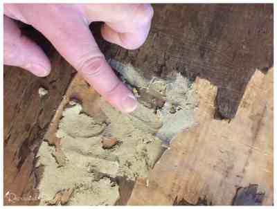 using your hand and wood filler to fix a dresser