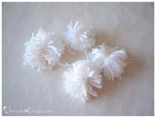 white yarn pom poms