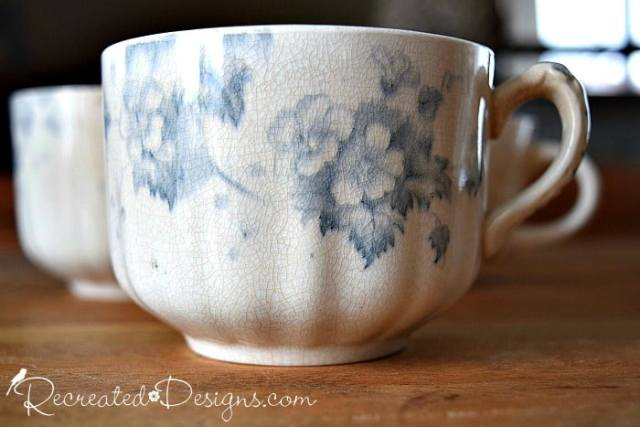 an cracked old English tea cup in blue and white