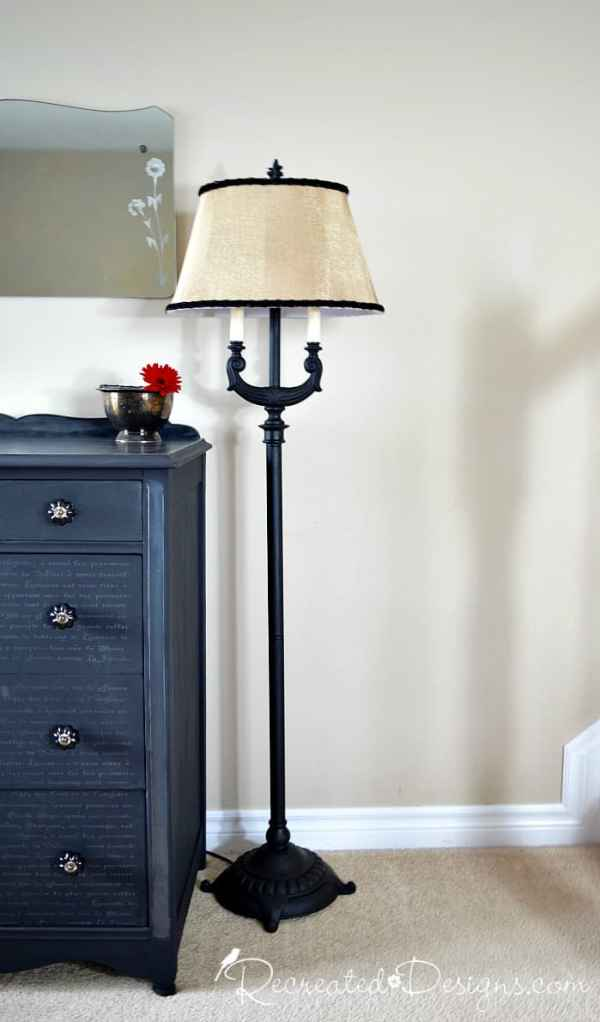 a vintage floor lamp that was painted black