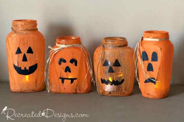 glass jars turned into Jack-O-Lanterns