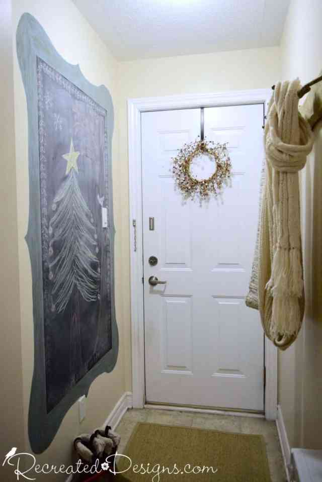 entry way with chalkboard painted on the wall