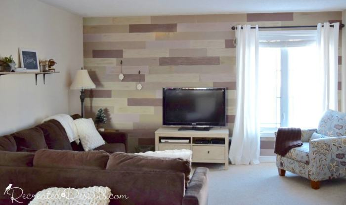 living room in an urban condo with a painted faux wood wall