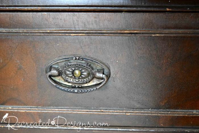 tin handles on old buffet
