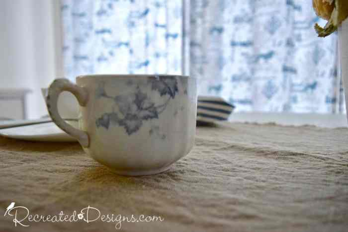old tea cup with blue flowers