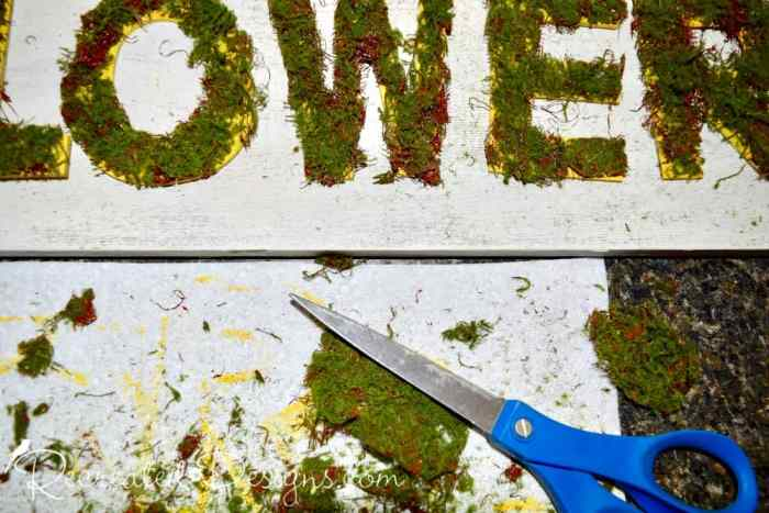 cutting moss ribbon to covered wood letters