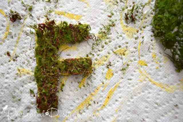using moss ribbon to cover painted wood letters