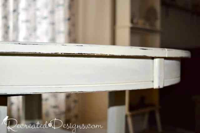 distressed edge of a painted table