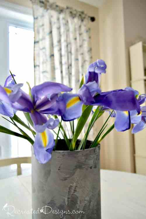 purple spring flowers in a painted vase