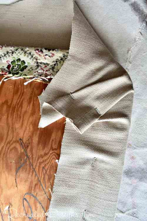 attaching fabric around the corner of a chair seat