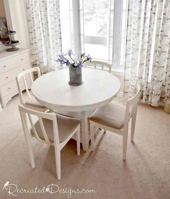 a cream and natural coloured dining room