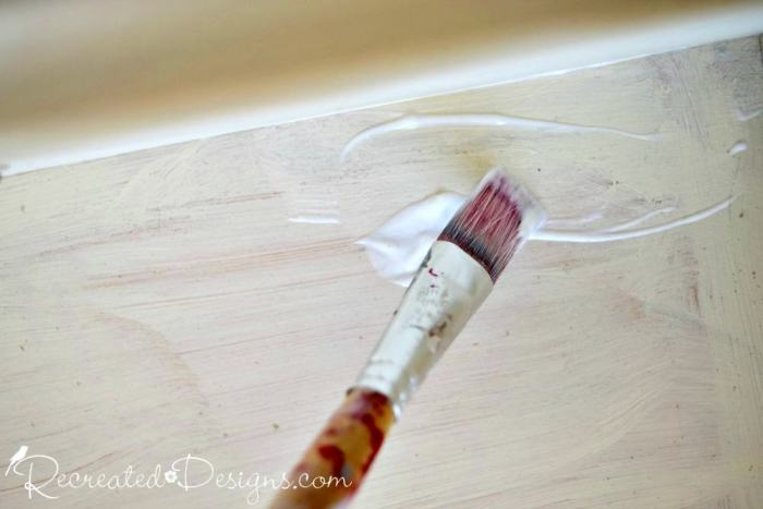 brushing on Country Chic Paint Transfer Medium on a painted drawer
