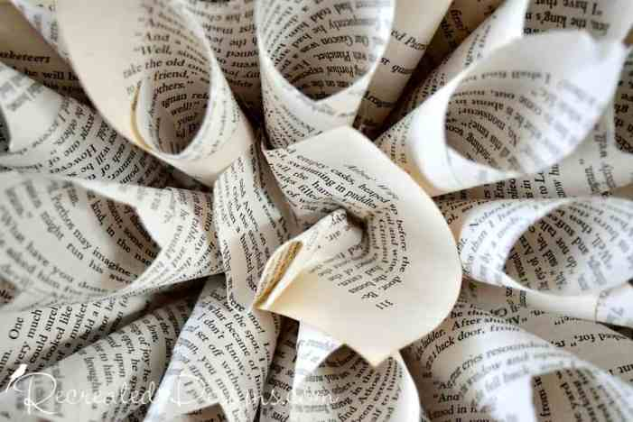 How to easily make a gorgeous book page flower recreated designs attching a centre to a paper flower made from book pages mightylinksfo