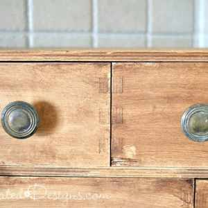 reclaimed knobs on stained pine drawers
