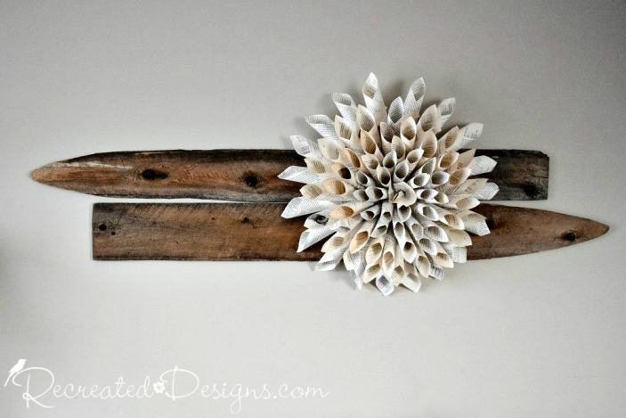 How to easily make a gorgeous book page flower recreated designs a paper chrysanthemum make out of old book pages hanging on two pieces of reclaimed wood mightylinksfo