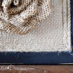 burlap over a reclaimed cork board with a painted black frame