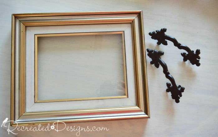 reclaimed frame and wrought iron handles
