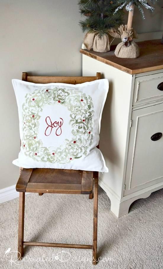 Joy pillow sitting on vintage folding chair