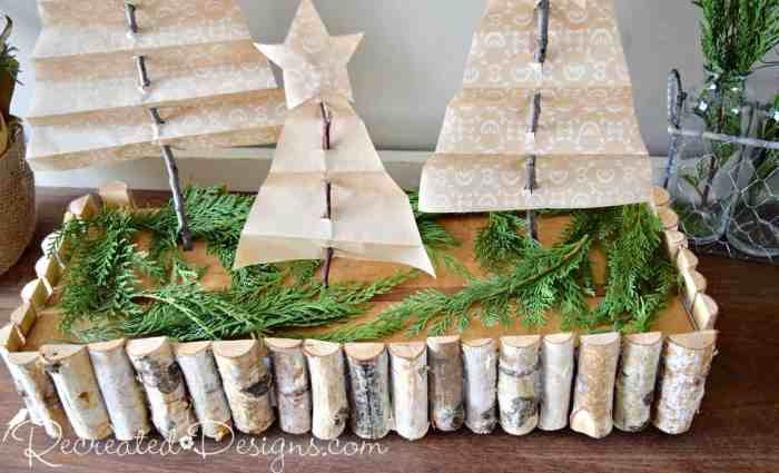 an old cutting board with greenery and pine branches