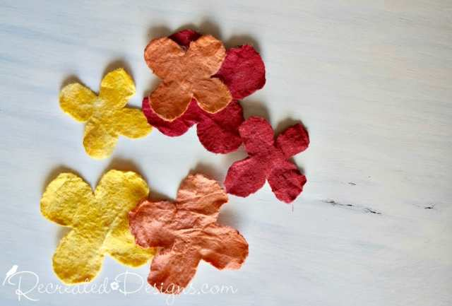 natural fibre flowers dyed in watered down paint