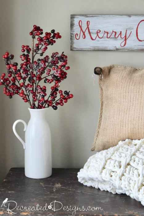 beautiful red berries in a white jug for Christmas