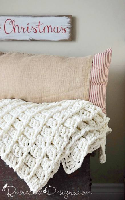 cozy cream blanket and burlap pillow ready for Christmas