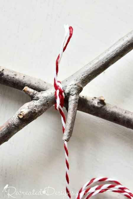 wrapping twigs with IKEA red and white twine