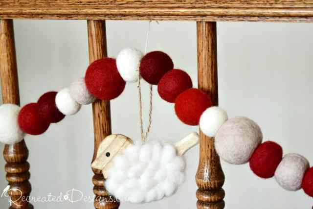 a rustic wool garland hanging from a banister