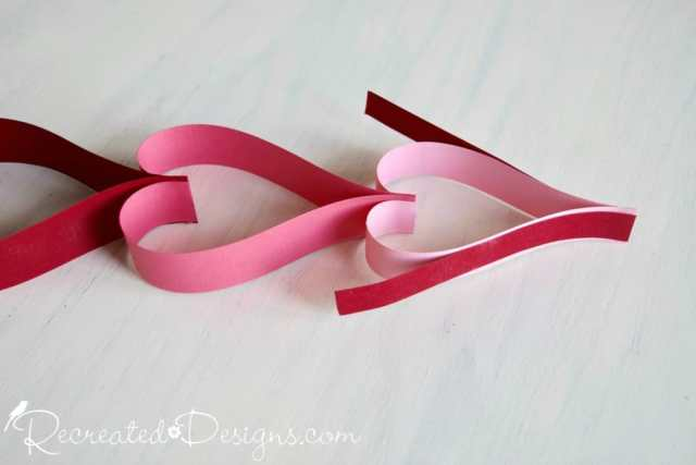 Making a paper heart garland by Recreated Designs