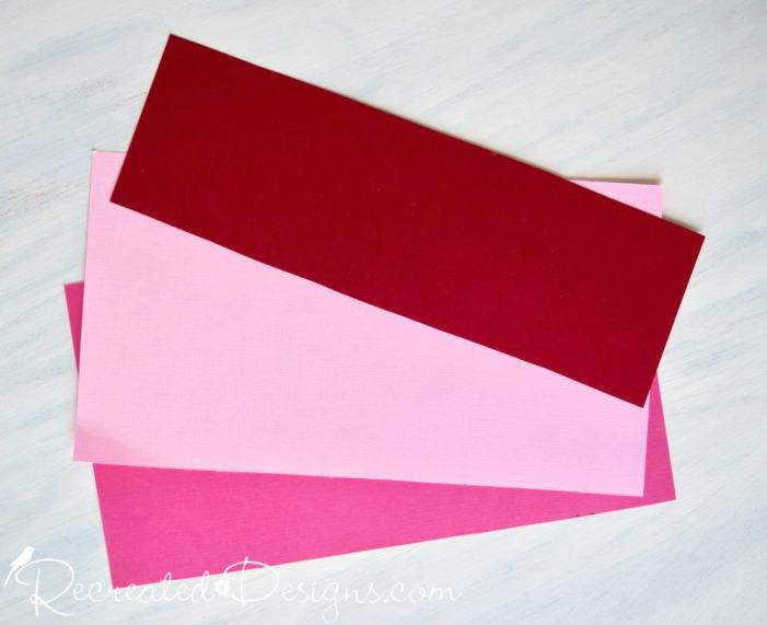 construction paper used to make a Valentine garland by Recreated Designs