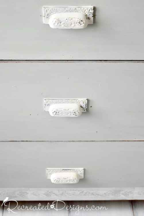 wrought iron furniture handles painted white on vintage dresser