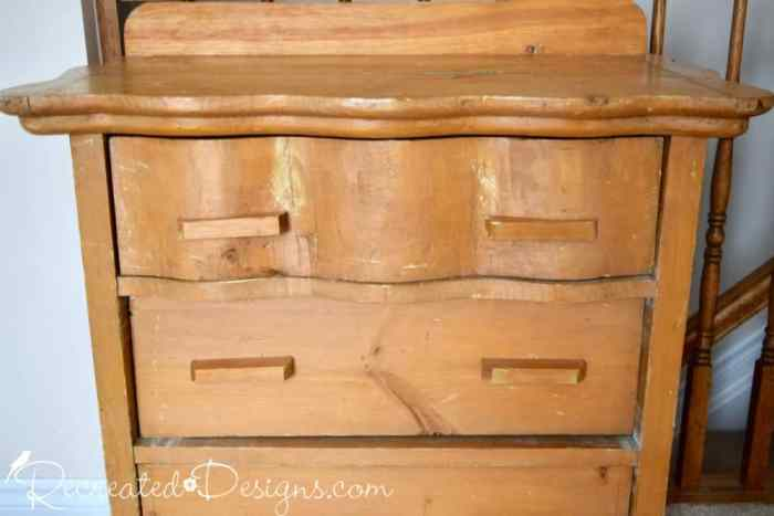 a beat up old dresser from the Habitat for Humanity store