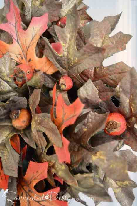 adding rose hips to a Fall wreath