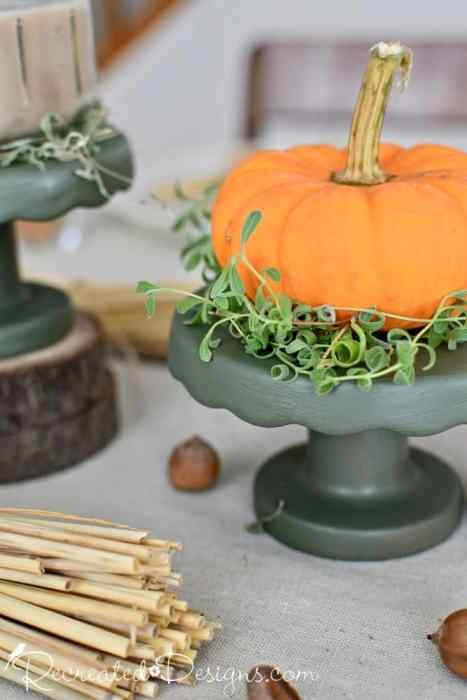 cupcake stands painted green with pumpkins
