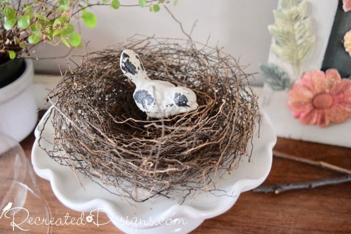 birds nest on an ironstone cake stand