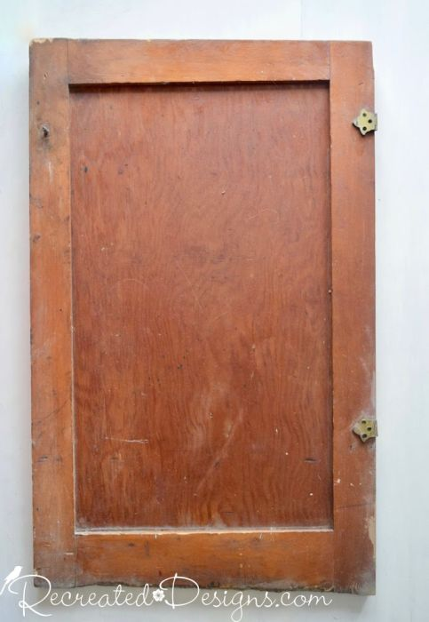 an old door before being upcycled