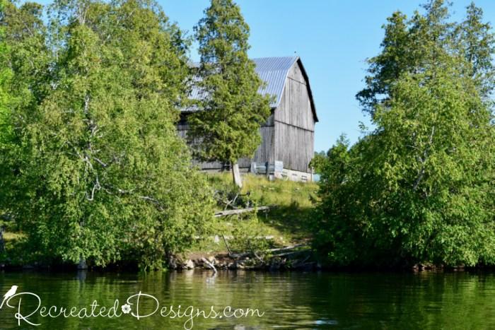 old barn at the edge of a lake