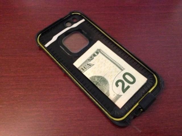 billete dinero celular escondido