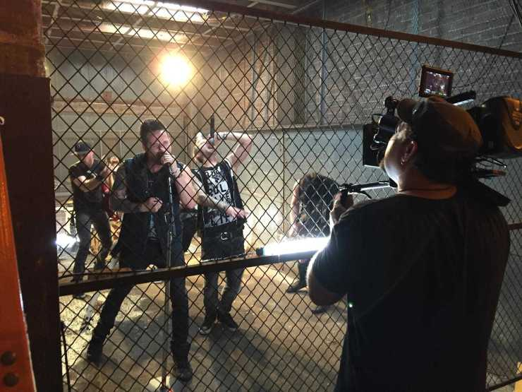 photo of Jim Foster shooting and directing the band From Ashes to New video